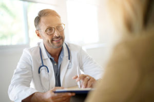 Lyme literate doctor discusses treatment with patient